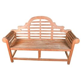 Vintage Wood Camel Back Bench: A vintage wood camelback bench. This Mission style bench features a slatted wood frame with a bracketed camelback and scrolled arms over straight legs that are connected by stretchers. There are no visible maker's marks.
