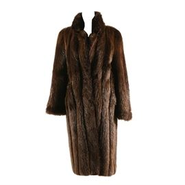 """Vintage Beaver Fur Coat by Garfinckles: A vintage beaver fur coat by Garfinckles. This women's dress coat features a short collar and a concealed hook and eye closure. Retains maker's label to the interior lining and embroidered previous owners name. Shoulder measured 19"""", sleeve length 24"""", hem 49""""."""