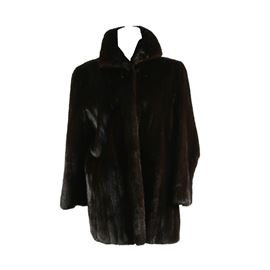 """Vintage Mink Fur Jacket by Alper-Richman Furs: A vintage ranch raised Mink fur jacket by Alper-Richman Furs. This women's jacket is a shorter length with a concealed hook and eye closure. Retains maker's label to the interior lining. Shoulder measured 18"""", sleeve length 22"""", hem 32""""."""