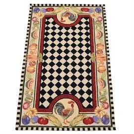 """""""Farmer's Market"""" Hooked Wool Area Rug By Capel: A hooked wool Farmer's Market are rug by Capel Incorporated. The rug features a black and white checkerboard pattern to center field, with a colorful vegetable motif guard border having sunflower accents in the corners and rooster motifs to opposite ends. The rug is finished with bound edges and an affixed woven fabric backing. Marked with a manufacturers label, indicating 100% wool pile content and manufacture in China."""