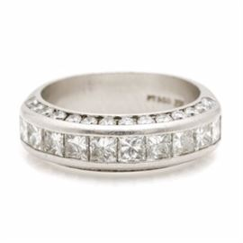 Platinum 2.45 CTW Diamond Ring: A platinum 2.45 ctw diamond ring. This ring showcases ten princess cut set across the crown accented by twenty-eight round brilliant cut diamonds adorned along the sides.