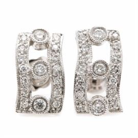 18K White Gold Diamond Earrings: A pair of 18K white gold diamond earrings. This pair of drop earrings showcase thirty-four round brilliant cut diamonds adorned throughout the openwork design. The total carat weight of all diamonds included is 0.32 ctw.