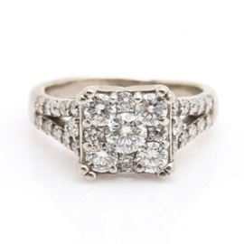 14K White Gold 1.05 CTW Diamond Ring: A 14K white gold 1.05 ctw diamond ring. Diamond encrusted split shoulders and an openwork under gallery support a square shaped crown of round brilliant cut diamonds.