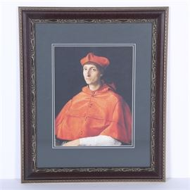 """Offset Lithograph After Raphael """"Portrait of a Cardinal"""": An offset lithograph on paper titled Portrait of a Cardinal after an original painting by Italian Renaissance artist, Raphael. The original painting currently hangs at Prado Museum in Spain. This print depicts a Catholic Cardinal dressed in red religious garments. It is inscribed in-plate to the lower margins. The print is matted in blue and presented behind glass in a textured wooden frame with a paper backing and metal hanging wire to the verso."""