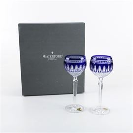 """Pair of Waterford """"Clarendon Cobalt"""" Crystal Hock Glasses: A pair of Waterford Clarendon Cobalt crystal hock glasses. Offered are two cut crystal hock glasses with a blue cut-to-clear motif and a beveled stem. The pieces are marked """"Waterford"""" and come with the original box and a booklet."""