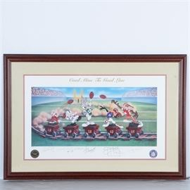 "Autographed Limited Edition Offset Lithograph ""Coal Mine to Goal Line"": A limited edition offset lithograph titled Coal Mine to Goal Line autographed by NFL quarterbacks Joe Montana, Joe Namath, Jim Kelly, Johnny Unitas, and Dan Marino. This print features a mine railway with a train of carts crossing a football field. On top of each cart is a character from Looney Tunes wearing the jersey and helmet of an accomplished quarterback from the state of Pennsylvania. Below the corresponding character, each player has autographed in the lower margin of the piece. The title is printed to the upper center margin, and the print is marked number 50 in an edition of 1000. Certificates of authenticity, information on each player, and photos of each man signing the prints are affixed to the verso. The piece is presented behind a mat and glass in a frame that has been wired for hanging."