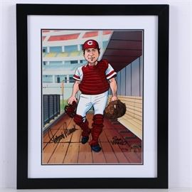 "Sam Viviano Limited Edition Sericel Autographed by Johnny Bench: A limited edition sericel print by artist Sam Viviano titled Johnny Bench, autographed by Johnny Bench. This work features a colorful caricature of Cincinnati Reds baseball player, Johnny Bench wearing his pitcher's uniform while walking through the dugout. It is hand-signed by the artist and Johnny Bench to the lower margins. This sericel print is marked with a gold tone seal and numbered ""H.C. 17/25"" by hand to the lower right corner. It is matted in white and presented behind glass in a black wooden frame with a metal hanging wire to the verso. Affixed to the verso is a certificate of authenticity from Classic Moments and a photograph of the artist."