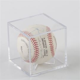 Mark McGwire Autographed Baseball: A Mark McGwire autographed Rawlings National League baseball. The ball is housed in a protective acrylic case. Mark McGwire signed to the left of the National League logo in blue ink pen.