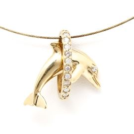 Wyland 14K Yellow Gold Diamond Dolphin Pendant Necklace: A Wyland 14K yellow gold diamond dolphin pendant necklace. This necklace features a high polish dolphin with a diamond eye jumping through a diamond encrusted hoop affixed to a wire necklace with a spring ring clasp.