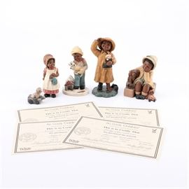 """Martha Holcombe Set of Four """"All God's Children"""" Figurines with Certificates: A collection of vintage M. Holcombe figurines. There are four ceramic pieces including """"Kacie,"""" """"Jacob,"""" """"Hope"""" and """"Bonnie"""". The latter piece includes a small figurine of a dog on a leash. All four pieces are incised with a 1980s-'90s year and Martha Holcombe's name. Additionally, the four pieces come with a limited edition certificate signed by the artist. The certificates read """"Miss Martha Originals, Inc. – All God's Children – Original artwork created by Martha Holcombe""""."""