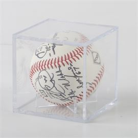 Multi Autographed Baseball Including Bob Gibson: A multi signed autographed baseball. This Wilson baseball features the signatures of Bob Gibson, John Frascatore, and others players in black ink. The ball is housed in a clear plastic case.