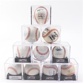 Signed Baseballs In Acrylic Cases: An assortment of signed baseballs in acrylic cases. Includes ten baseballs, signed by various players, such as Ray Lankford, Adam Wainwright, Brendan Ryan and Jason Isringhausen as a few highlights. Includes spring training baseballs and at least one All-Star week baseball.