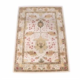 Persian Style Machine Woven Wool Area Rug: A machine-woven wool area rug. The design features an open arrangement of herati worked in shades of green, saffron, buff, tan, rust, and faded red on an off-white field. The compound borders of stylized flowers and foliage combine with palmettes in the same palette. There is no fringe. The number 061840-19 has been written in black ink on the back of the rug.