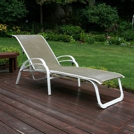 Brown Jordan Patio Lounge Chair: A Brown Jordan patio lounge chair. The chair features painted white metal framing with taupe-colored woven vinyl seating. Matches a set of four patio armchairs by Brown Jordan sold separately in the sale as item 17BOS141-191.