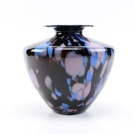 """Italian Black and Blue Art Glass Vase: An Italian art glass vase. This piece features a wide ovoid-shouldered form with a flared lip. The vase is composed of a black hued glass with blue and gray speckles around the neck and body. The underside is marked to a label """"Made in Italy""""."""