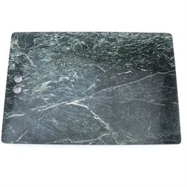 """George Briard Marble Cutting Board: A George Briard marble cutting board. The board is formed of dark green marble with white veins. The board has two finger holes to the side and is marked with a gold foil sticker """"George Briard Mc"""" to the underside."""