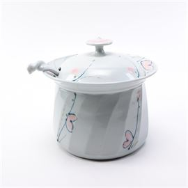 Artisan Soup Tureen with Ladle: An artisan soup tureen with ladle. The tureen has a white ceramic lid and body with line and heart accents. A soup tureen is included. The underside of the tureen features an artist's name.