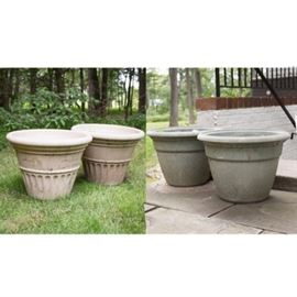 Four Plastic Planters: A group of four plastic planters. This includes two double-walled planters from Pottery Collaborative, Inc. Also included are two plain planters.