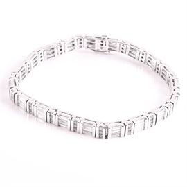 14K White Gold 6.00 CTW Diamond Line Bracelet: A 14K white gold 6.00 CTW baguette and round diamond line bracelet.