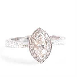 14K White Gold Marquise Diamond Halo Ring: A 14K white gold marquise diamond halo ring with an engraved wheat motif and milgrain details.