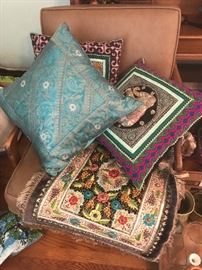 Indian pillows on a mid Century chair