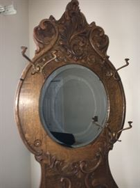 One of two antique hall trees with mirrors.
