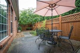 nice wrought iron patio set with umbrella