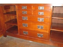 Mission Collection Syracuse Sideboard Derived from the sideboard that once graced Gustav Stickley's home in Syracuse, New York, this impressive Mission sideboard includes two cupboard doors fitted with two adjustable shelves behind each. Four small drawers and three graduated drawers line the center of the piece with a Pacific Silvercloth® liner located in the third drawer down from the top.