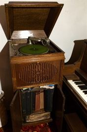 Brunswick wind-up phonograph with lots of early phonograph records.