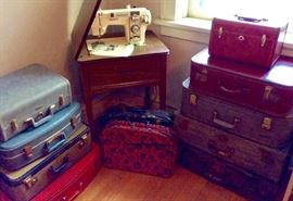 Vintage luggage and Morse sewing machine.
