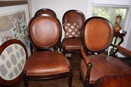 A few of the 8 Baker dining chairs