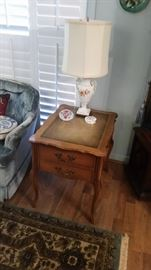 End table with leather top.