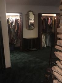 Foyer cabinet and mirror plus 2 closets full of vintage  clothing in the Closet Hall!