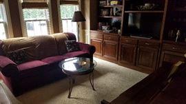 "Flexsteel sleeper/sofa with ""Moon"" and ""Sun"" glass top table, books, Sony TV"