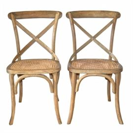 Pair of Restoration Hardware Side Chairs: A pair of Restoration Hardware side chairs. Chairs feature intentionally distressed frames in a natural wood finish and cane seating.