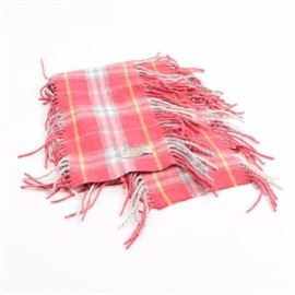 Burberry Wool Blend Scarf: A wool blend scarf by Burberry. This scarf showcases a plaid motif and a fringe presented in shades of pink, yellow, gray and white. It is marked with a brand label. Made in Scotland.