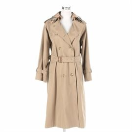Women's Burberry Trench Coat: A trench coat by Burberry. This double-breasted jacket showcases a tan cotton blend exterior with matching belt and a signature plaid lining. Also featured is a removable signature plaid attachment that fastens with button closures over the original collar. This item is marked with interior brand labels.