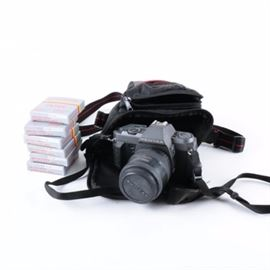 Pentax P30T Camera and Accessories: A Pentax P30t camera with accessories. This Pentax 35 mm SLR camera features a 35 – 80 mm zoom lens and shoulder strap. The camera is presented with a black camera bag and six Quantary filters.