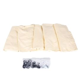 Five Drapery Panels and Accessories: A set of five drapery panels with accessories for hanging. The panels are made of textured fabric woven in pale yellow and soft white. They have been lined. The accessories include bags of rings for hanging and assorted screws.
