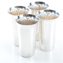 """Set of International Silver Co. Sterling Tumblers: A set of sterling silver tumblers by International Silver Co. This set includes four tumblers featuring a slightly fluted rim leading to a cylindrical form. The underside of the tumblers are marked, """"International Sterling."""" The total approximate weight is 19.585 ozt."""