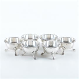 """Set of Plateria Farfan Mexican Sterling Silver Egg Cups: A set of Plateria Farfan Mexican sterling silver egg cups. This set includes six egg cups featuring beaded rims and claw feet. The underside of the egg cups are marked, """"Sterling Mexico,"""" with an stamped eagle 13 hallmark. The total approximate weight is 8.035 ozt."""