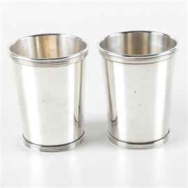 """International Silver Co. Sterling Mint Julep Cups: A pair of sterling silver mint julep cups by International Silver Co. These cups feature a reeded border along the rim and the base. They are marked to the undersides """"International Sterling 101 25 -1"""". The total approximate weight is 7.715 ozt."""