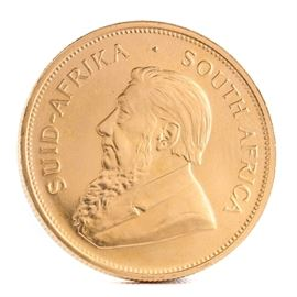 """1984 South African 1 Ounce Fine Gold Krugerrand Coin: A 1984 South African 1 ounce fine gold Kruggerand. This coin, minted by the South African Mint and 32.8 mm in diameter, features the likeness of Paul Kruger, South Africa's first president, along with """"South Africa"""" in Afrikaans and English to obverse. The reverse displays the year of minting and gold weight along with the image of the national animal of South Africa, a Springbok antelope. Presented in a clear plastic sleeve."""
