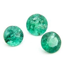 Loose Emerald Gemstones: A grouping of three loose emerald gemstones.