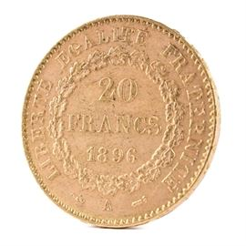 1896 France 20 Francs Gold Coin: An 1896 France 20 Francs gold coin. This coin, with a fineness of 0.9000 and weight of 6.4516 g, features a standing genius writing the constitution, rooster at right, and fasces at left to obverse. The reverse depicts the denomination above the date within a circular wreath. Presented in a clear plastic sleeve.