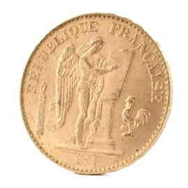 1897 France 20 Francs Gold Coin: An 1897 France 20 Francs gold coin. This coin, with a fineness of 0.9000 and weight of 6.4516 g, features a standing genius writing the constitution, rooster at right, and fasces at left to obverse. The reverse depicts the denomination above the date within a circular wreath. Presented in a clear plastic sleeve.
