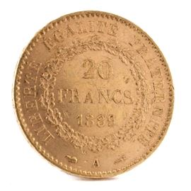 1889 France 20 Francs Gold Coin: An 1889 France 20 Francs gold coin. This coin, with a fineness of 0.9000 and weight of 6.4516 g, features a standing genius writing the constitution, rooster at right, and fasces at left to obverse. The reverse depicts the denomination above the date within a circular wreath. Presented in a clear plastic sleeve.