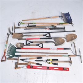 "Large Assortment of Lawn Tools: An assortment of lawn tools plus a raised platform ladder. The tools include: a 95"" long tree trimmer, four rakes, four shovels, one snow shovel, a pitch fork, a two-prong hoe, a Weed Hound, a 70"" long black iron tamper, 36"" level, and a scuffle hoe. The hand tools include a pair of hedge trimmers, a three-prong hoe, a hand spade, a pair of lobbers, a pickaxe, and a 41"" long x 18"" raised aluminum raised platform."