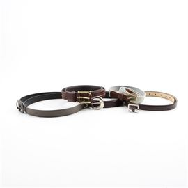 "Assortment of Waist Belts: An assortment of five unisex waist belts. Some highlights of this assortment include a light blue woven strap belt containing a brown leather adjustable buckle; a plain brown leather waist belt by Another Line, Inc. in a size large; and a gray leather waist belt stamped ""38"" and ""Mexico"" to the interior."