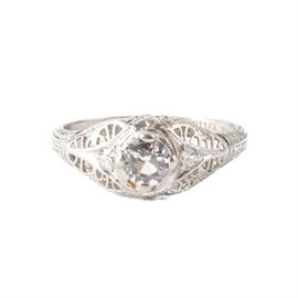 Platinum YAG and Diamond Ring: A platinum YAG (yttrium aluminum garnet) ring with diamond accents in a reticulated setting.
